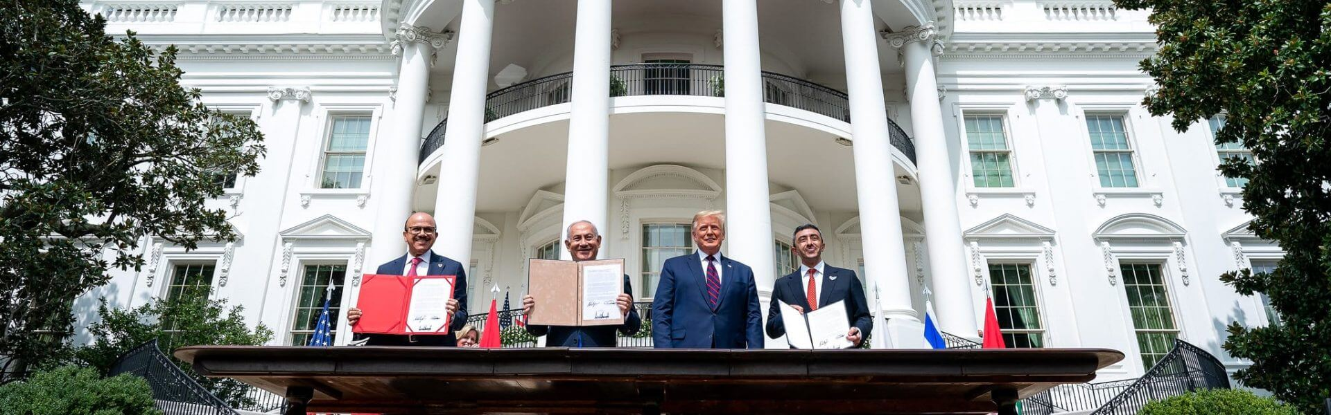 President Donald J. Trump, Minister of Foreign Affairs of Bahrain Dr. Abdullatif bin Rashid Al-Zayani, Israeli Prime Minister Benjamin Netanyahu and Minister of Foreign Affairs for the United Arab Emirates Abdullah bin Zayed Al Nahyanisigns sign the Abraham Accords Tuesday, Sept. 15, 2020, on the South Lawn of the White House. (Official White House Photo by Tia Dufour)